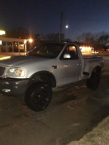 Lifted 2002 ford fx4 pickup.
