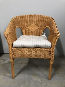 Wicker cane chair with cushion