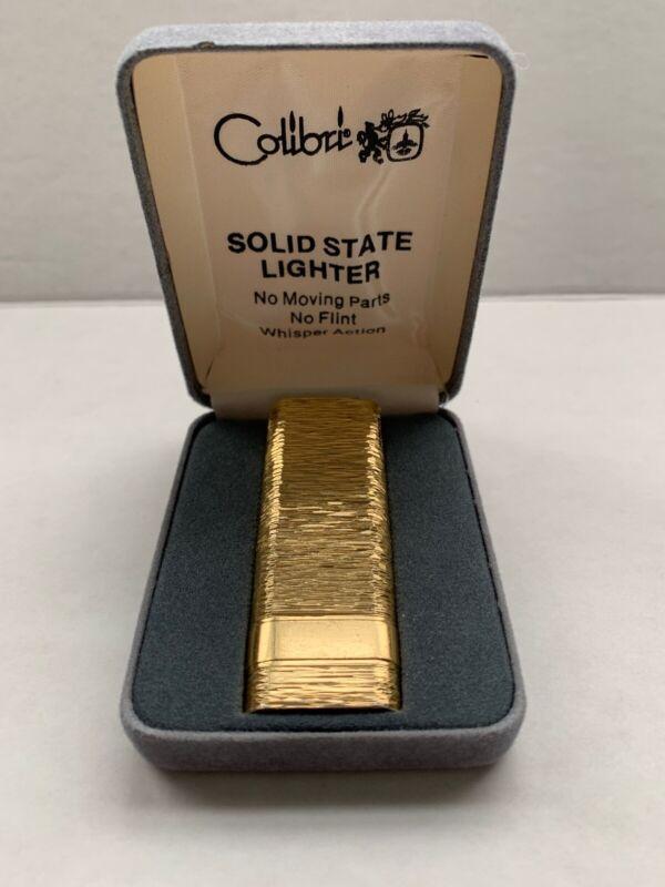 COLIBRI LIGHTER SOLID STATE GOLD TONE - tiny spark lights up !