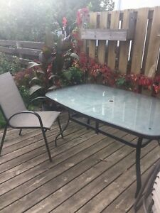 Patio table with six chairs and umbrella