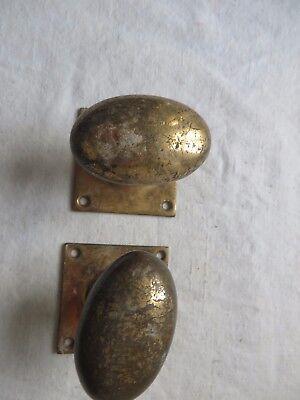 Pair of Victorian door knobs brass oval