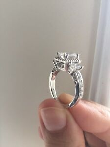 14K white gold with synthetic diamonds.