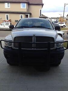 2003 Dodge Ram + free 4 Panther Rims