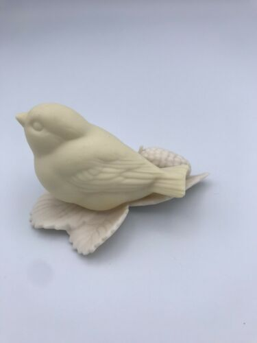 Off-white or beige porcelain/ceramic Bird with pinecone, marked Christmas