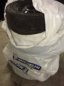 4 winter Blizzak tires and rims for sale