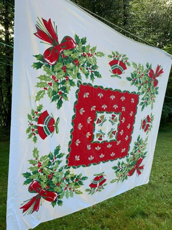vintage tablecloth mid century 52x48 Christmas bells, holly, ribbon, some stains