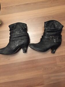 Leather high heeled boots size 6.5