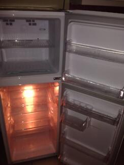 Medium sized fridge/freezer.