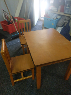 Kids solid wooden table with two chairs