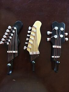 Guitar style wall hangers.