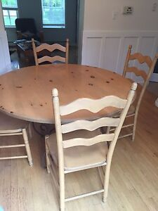 Solid wood round kitchen table with four chairs