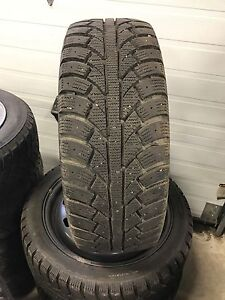 Four used tires and rims