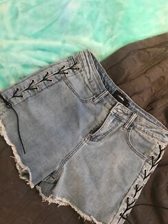 denim shorts with black lace tie