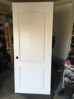 Pure white brand-new door with arch detailing  with hinge