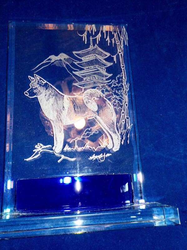 Spectacular Akita crystal art piece double engraved and signed by Ingrid Jonsson
