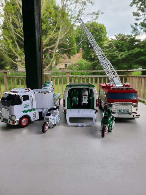 Hess Truck Lot. 2005 Hess Toy Firetruck And Jeep. 2006 Hess Toy Truck And...