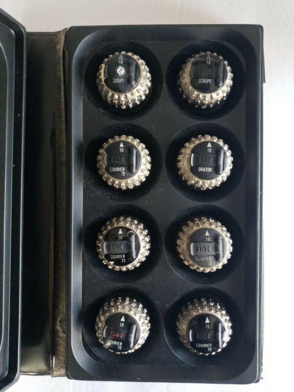 Lot of 8 IBM Selectric typewriter font balls with case-