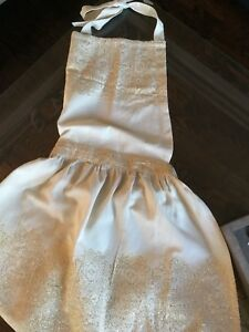 Anthropologie Apron detailed in gold accents**New with Tags