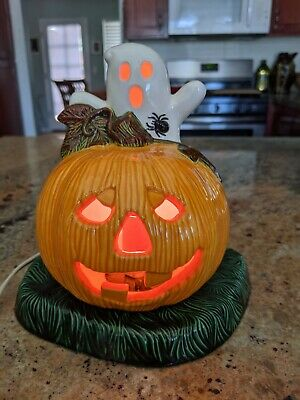 Halloween Ceramic Pumpkin With Ghost and spider- blinking bulb on green base