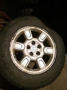 245/65R17 Toyo Open country Snow tires on Honda alloy wheels