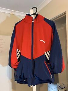 Nike Windrunner Jacket RedBlue. Hardly worn so in Depop