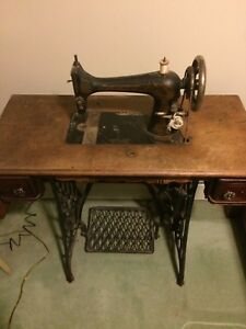 Singer sewing machine and old Barbie mirror