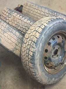 4 winter studded tires on rims 195/70/14