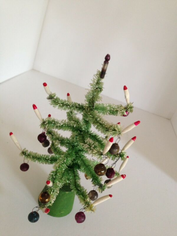 An Antique Miniature Christmas Tree With Green Base
