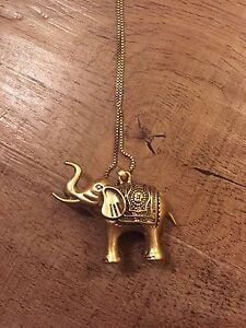 heavy gold elephant statement necklace