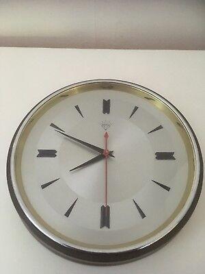 Vintage/Mid Century Industrial Shanghai Diamond  battery operated wall clock.
