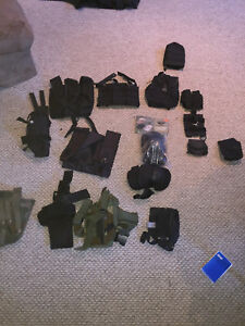 assorted paintball gear molle and velcro attachments