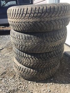 Four studded winter tires lots of tread 215/65r16 $100