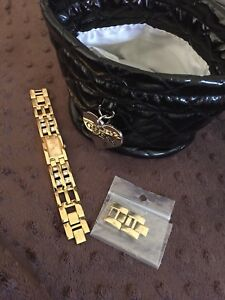 Guess watch with extra links and pouch
