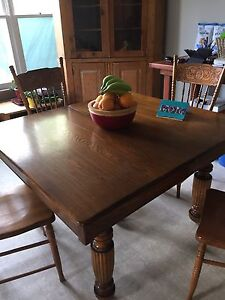 Antique table with press back chairs