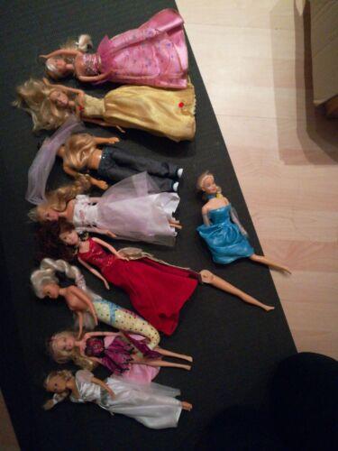 Verschiedene Barbie s, gebraucht