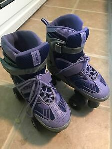 Girls size 1-4 adjustable roller skates.