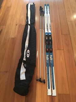 Cross Country skis, boots, poles, bag