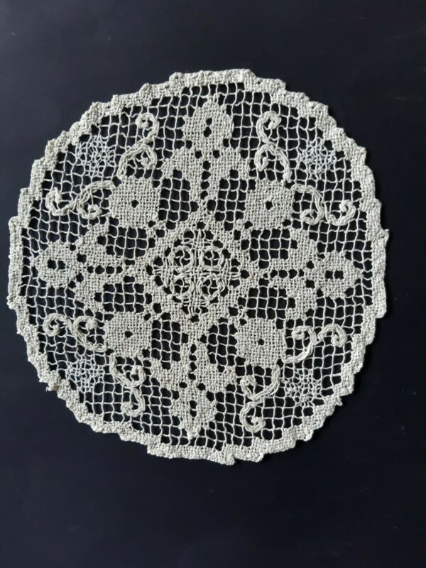 Vintage lace round cream doily with diamond shaped centre.
