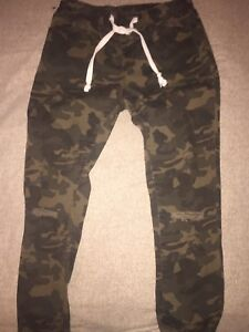 Women's small camo pants with drawstring and knee rips