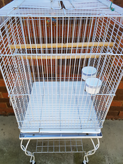 Large clean bird cage on stand.