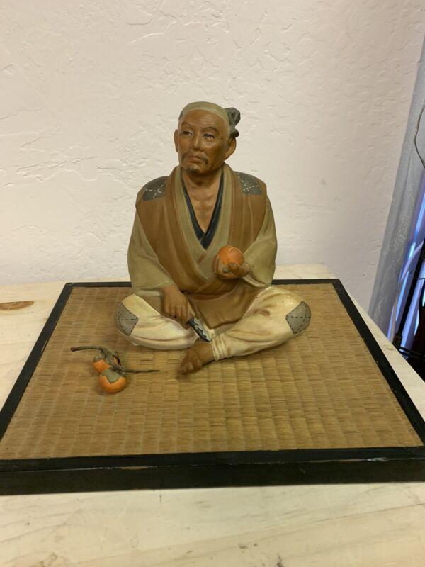 Hakata Mimasu Doll Man cutting Persimmons
