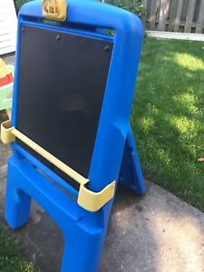 Outdoor chalkboard and water table.