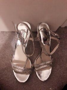 fcf9e6be9fda Michal Kors Yvonne Silver Dress Sandals