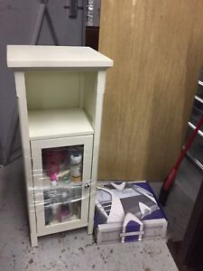 Small single door cabinet with glass insert