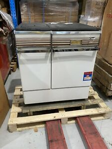 Slow combustion wood fired stove with oven