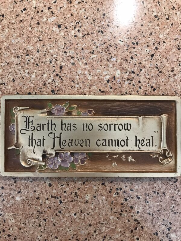 """A.E. Mitchell plaque """"earth has no sorrow that heaven heal can't heal"""""""