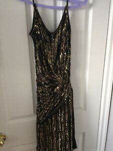 Black and gold sequin dress. Party.