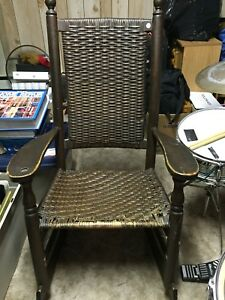 Antique wood rocker with woven seat