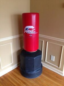 Adjustable height punching training bag