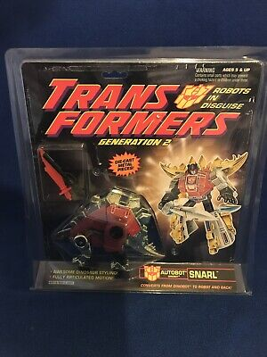 Snarl Transformers G2 Dinobot Snarl in package 1992 Hasbro red Gold